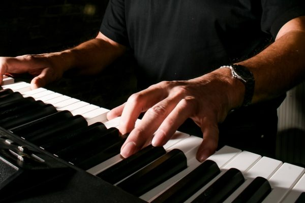 man-playing-keyboard-piano